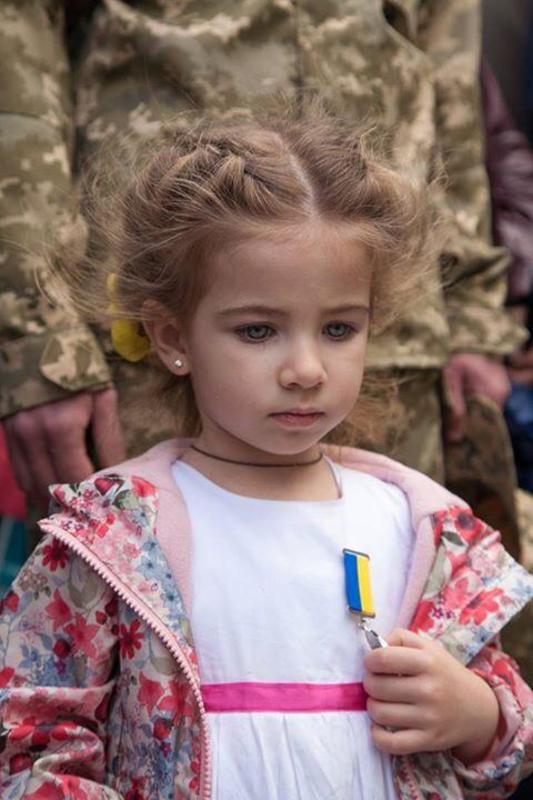 Ukrainian children receive awards for their fallen hero